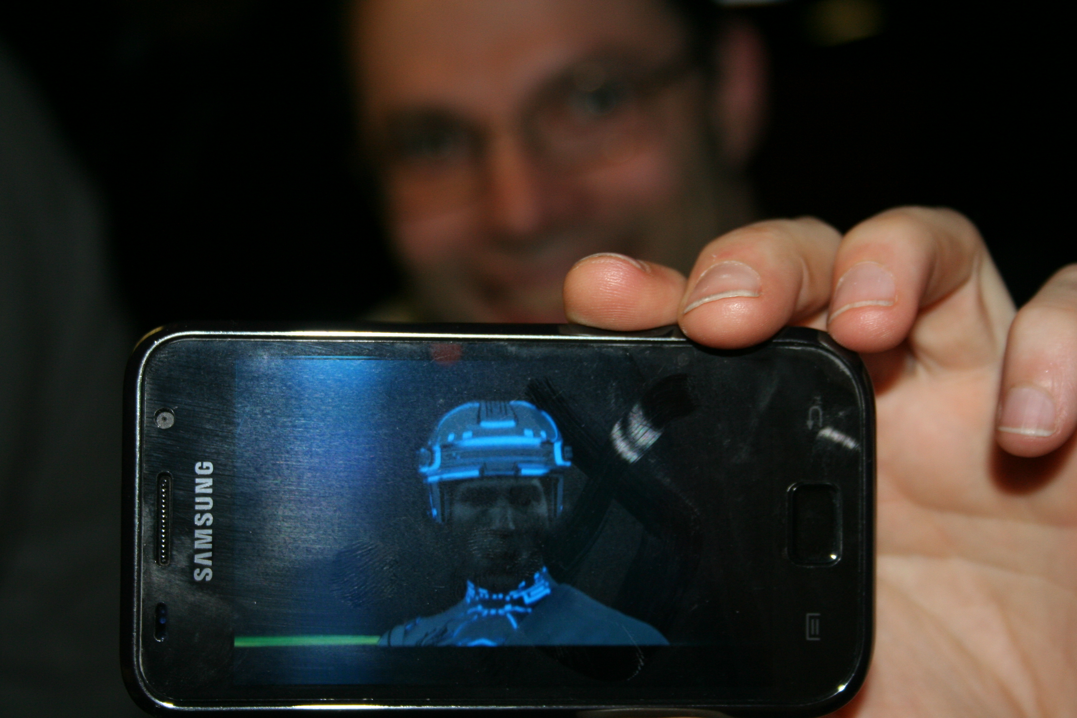 Trying out the new smartphone app that shows what you'd look like in the Tron universe.
