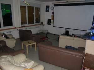 "Huge 135"" screen with lots of couches for your viewing pleasure"